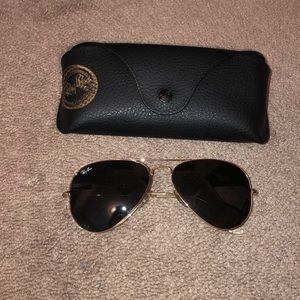 Black and gold aviators